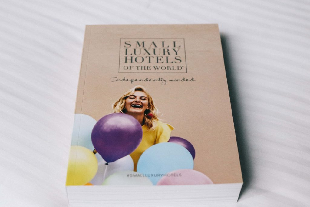 A book with the title 'Small Luxury Hotels'.