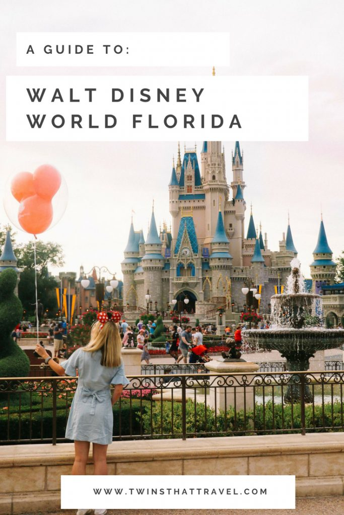 A girl stood with a balloon in front of Cinderella's Castle in the Magic Kingdom at Walt Disney World, Florida.