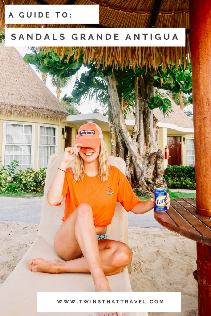 A girl drinking a beer at Sandals Grande Antigua Resort. Text overlay reads: 'A guide to: Sandals Grande Antigua' by 'Twins That Travel'.
