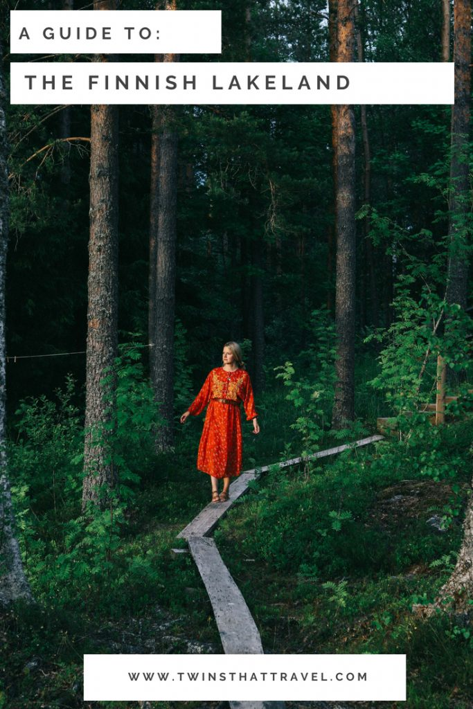 A girl stood in a forest in Tampere, Finland. Text overlay reads 'a guide to Finnish Lakeland'. Written by 'Twins That Travel'.